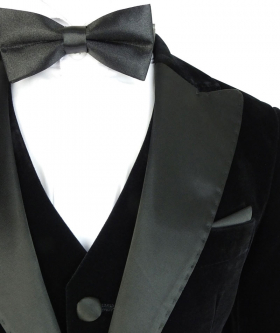 Near view from the bow tie of the Romano Boys Velvet Tuxedo Suit with Black Sheen Lapel