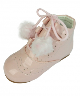Left shoe view of the Baby Girls Shoes Patent Spanish Pom Pom Boots in Pink